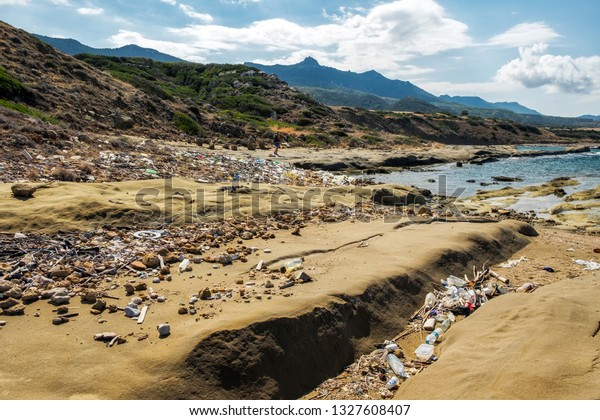 Abandoned beach full of garbage brought by the Mediterranean sea at the coast of Northern Cyprus.