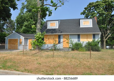 Abandoned Boarded Up Home in Suburban Residential Neighborhood