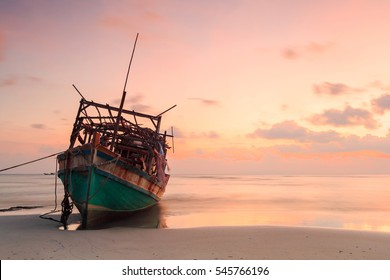 abandoned boat at beach in twilight Time with beautiful pink sky, Samui island thailand. long exposure, shooting in long exposure mode and has copy space
