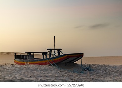 Abandoned boat in the dunes