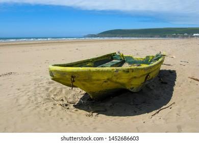 Abandoned boat on Salcombe beach on the Southwest coast of England
