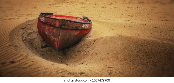 Abandoned boat on the sandy beach