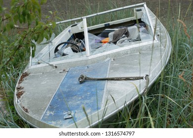 Abandoned boat sitting on shoreline