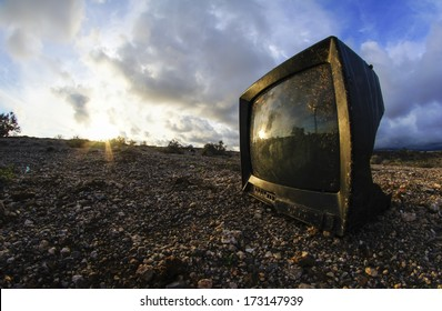 Abandoned Broken Television in the Desert on a Cloudy Day