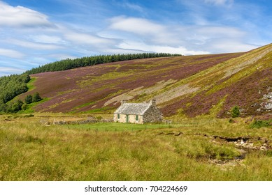 An abandoned building along a road in the Cairngorms National Park in Scotland