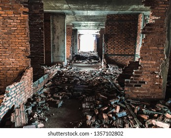 Abandoned building with bricks broken down all over the floor