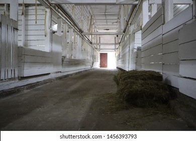 abandoned building. farm shelter in the barn with haystacks.  Inside a Barn for Farm Animals like Cows or Horses. Interior of Old abandoned empty barn.
