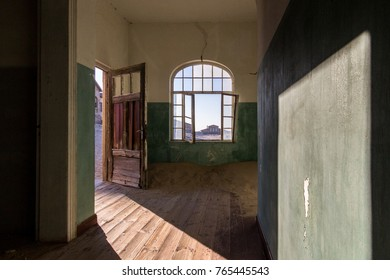 Abandoned building in ruins being taken over by enroaching sand, Kolmanskop ghost town, Namibi Desert, Namibia