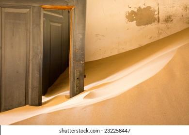 Abandoned building taken over by encroaching sand, Kolmanskop ghost town, Namib Desert