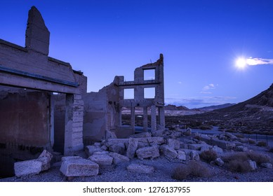 Abandoned building in the town of Rhyolite, Nevada at night with full moon. This ghost town is located in Nye County among Bullfrog Hills near Death Valley.