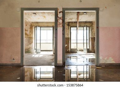 abandoned building, view room from the corridor, two doors