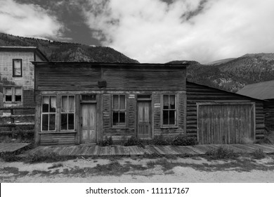 Abandoned Building with Wooden Sidewalk in Western US Ghost Town
