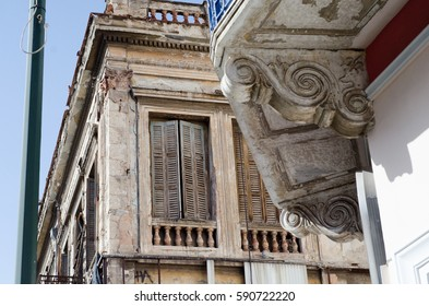 abandoned building with wooden windows and marble detail facade marble top view balcony Ionic