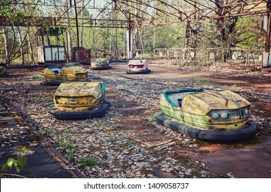 abandoned bumper cars in ruined amusement park in Pripyat city, Exclusion zone of Chernobyl, Ukraine, Eastern Europe
