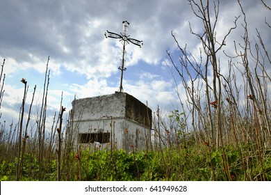 Abandoned bunker from Second World War with metal cross on top of it. Bulgarian Black sea coast, near town of Chernomorets.
