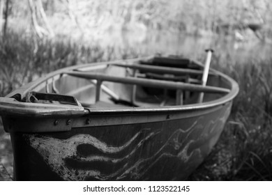Abandoned canoe on the shore of Double Lake Campgrounds in the Sam Houston National Forest.