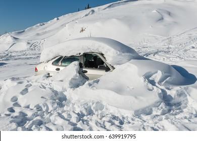 Abandoned car get struck in snow during winter in Alaska
