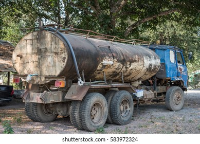 Abandoned car tank. Petrol Trucks with rust chrome tank.  car and fuel or gas tanker truck side view. transport loads