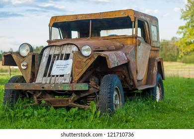 Abandoned car wreck by unknown mark found in World War 2 battlefield