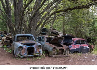 Abandoned cars at cementery in forest of Bastnäs in Sweden