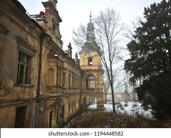 Abandoned castle with tower in the winter park in the fog in the Czech Republic