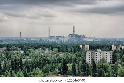 Abandoned Chernobyl station and city ruins after nuclear reactor explosion.  Winter season. Destroyed post apocalyptic living house.