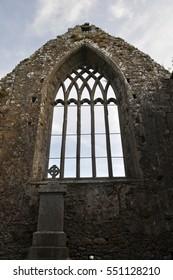 Abandoned Church in a Small Town in Ireland - Haunting Memories of a Time Gone By - Looking Upwards - Large Window and a Tombstone