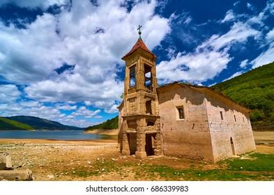 Abandoned church St Nicholas in Mavrovo village next to Mavrovo lake, Macedonia
