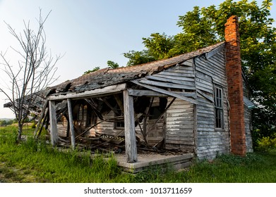 An abandoned and collapsing house, with clapboard siding, as seen in Kentucky.