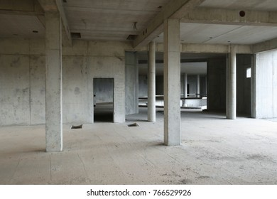 Abandoned construction site with bare concrete walls.