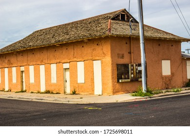 Abandoned Corner Building With Boarded Up Windows