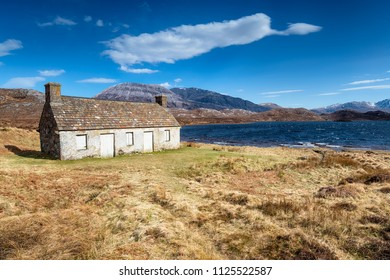 An abandoned cottage on the shores of Loch Stack in Scotland