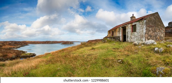 An abandoned cottage perched above Lockskipport on the Isle of South Uist in the Outer Hebrides in Scotland
