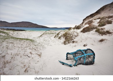 Abandoned creel lobster pot on Bagh A'Deas Beach, Vatersay, Outer Hebrides, Scotland