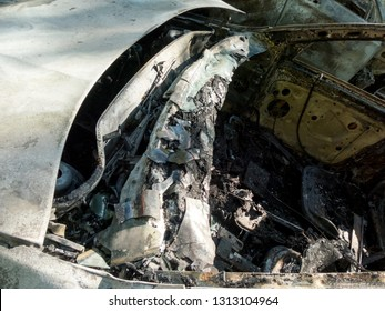 Abandoned damaged and burnt out car