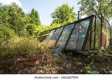 Abandoned dangerous green house image