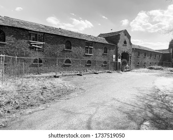 Abandoned derelict farm building in black and white