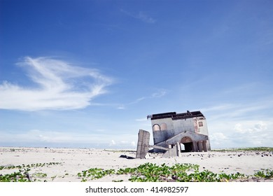 An abandoned and deserted house in the middle of nowhere in order to be demolished.
