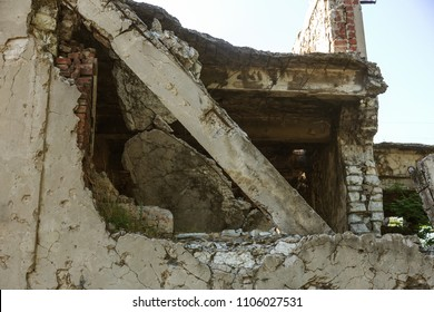 Abandoned destroyed by the explosion, bombing and shelling the destroyed building. Holes from shells, traces of bullets and splinters on the walls of a war-ravaged building. Old ruined house