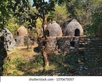 Abandoned and destroyed Maharishi Mahesh Yogi's Ashram.  Abandoned meditation cells in the Indian jungle. The Beatles Ashram