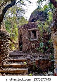 Abandoned and destroyed Maharishi Mahesh Yogi's Ashram.  Abandoned meditation cells in the Indian jungle. Cottage for one student.