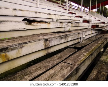 Abandoned and deteriorated bleachers in diminishing perspective