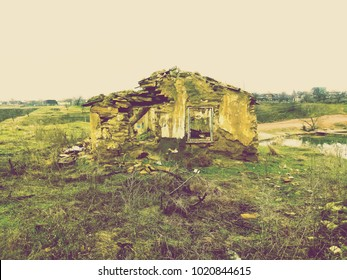 Abandoned and devastated house in Ukraine, Donbass. Forgotten place. Ruins of a city. Apocalyptic landscape. Damaged by grenade explosion in the war zone.