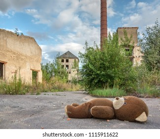 Abandoned and dilapidated factory overgrown of vegetation