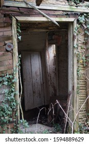 Abandoned doorway of an old rotting house