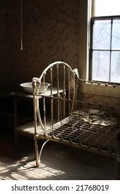 Abandoned eerie looking bedroom in Ghost town