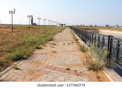 abandoned embankment. weeds grow through the tiles