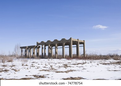 Abandoned facility of old munitions manufacturer with smokestacks in background