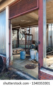 abandoned factory chemical components with rusty pipes and machines