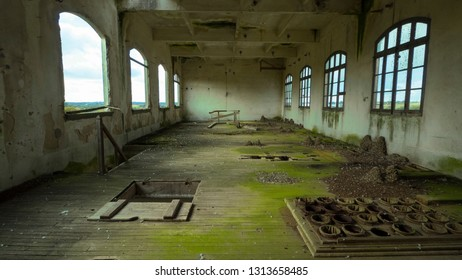 Abandoned factory and office interior with bright light. Near Rennes-city, Brittany, France